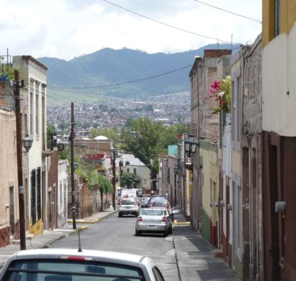Morelia, City street, cars, hills, houses