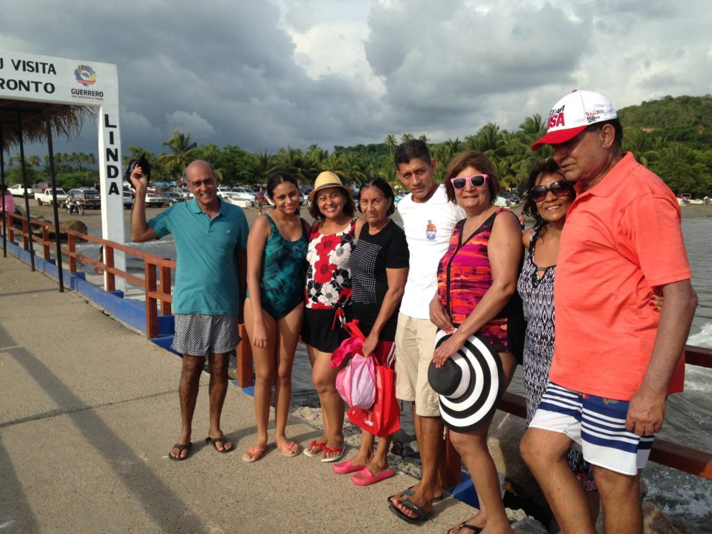 with-the-nice-mexican-family-that-adopted-us_-after-returning-from-isla-ixtapa